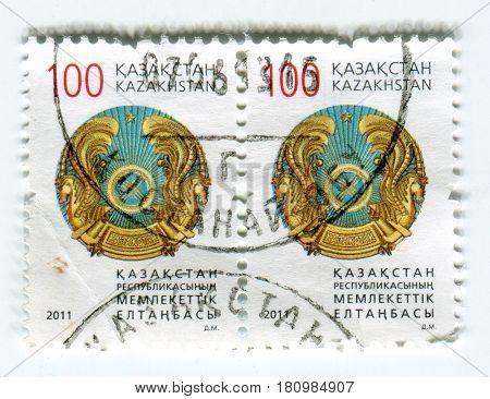 GOMEL, BELARUS, APRIL 7, 2017. Stamp printed in Kazakhstan shows image of  The coat of arms Kazakhstan, circa 2011.