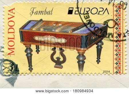 GOMEL, BELARUS, APRIL 7, 2017. Stamp printed in Moldova shows image of  The cimbalom is a concert hammered dulcimer: a type of chordophone composed of a large,  circa 2014.
