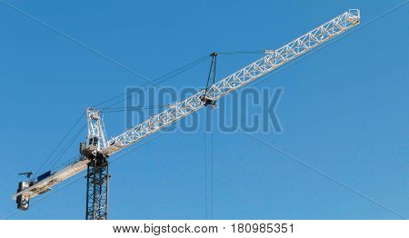 Building crane lifting material at a construction site
