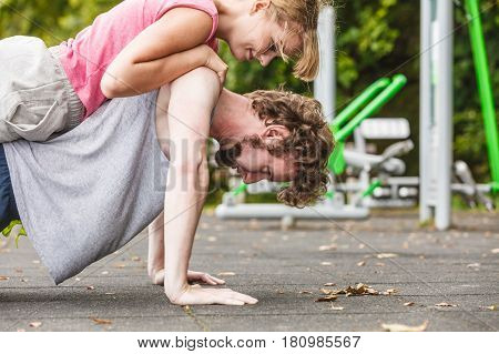 Man And Woman Doing Push Ups Outdoor.