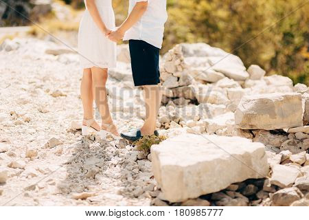 Couple holding hands in the mountains. Newlyweds in the mountains holding hands. Wedding in Montenegro.