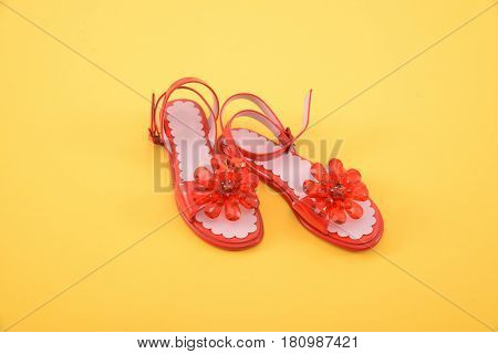 female red shoes-yellow background