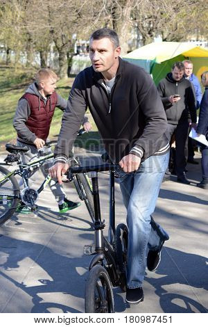 Kiev, Ukraine, April 9, 2017. Mayor of Kiev Vitali Klitschko riding a bicycle