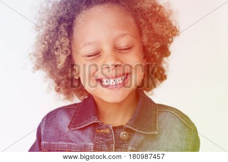 Boy standing and making facial expression