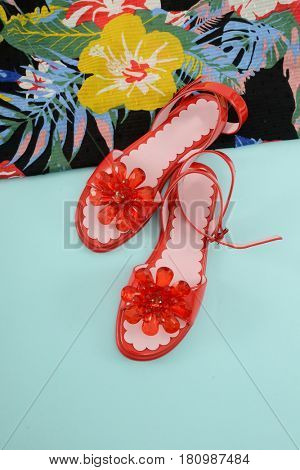 Fashion. Summer woman accessories-Summer floral scarf, red shoes on blue background