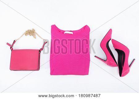 Fashion concept. Pink handbag , shoes ,shirt on a white background