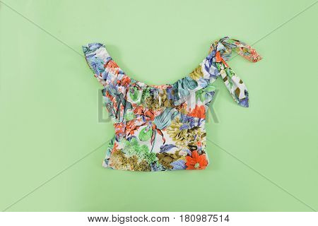 Fashion. Summer woman accessories-Summer floral clothes on green background