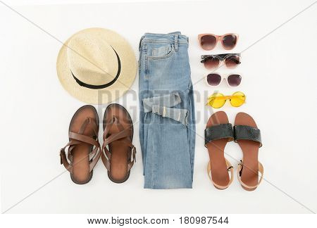 Jeans with sunglasses ,hat, on white background.