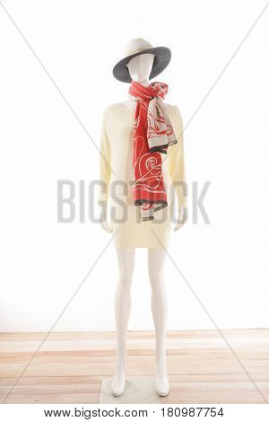 full-length female clothing with hat,scarf on mannequin-wooden background