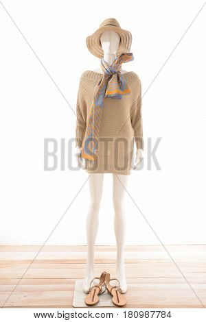 full-length female clothing with hat and scarf ,shoes ,handbag on mannequin