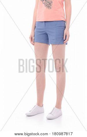long sexy legs wearing short blue shorts-white background