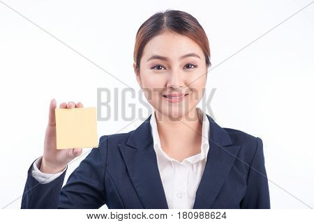 A Portrait Of A Young Smiling Business Woman Showing Blank Sticky Note Isolated On White Background.
