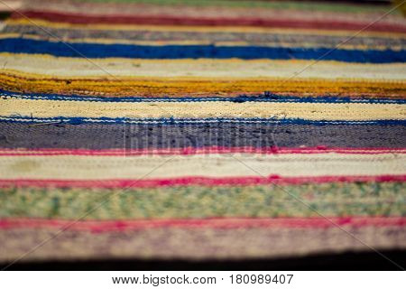Colored striped traditional color carpet in home