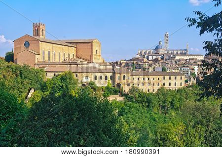 Basilica di San Domenico and the Cathedral Duomo of Siena from the Medici Fortress - Siena, Italy