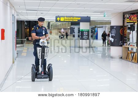 BANGKOKTHAILAND-February 162017: Airport Police on duty using Segway to patrol and security around the Terminal for prevent terrorist.