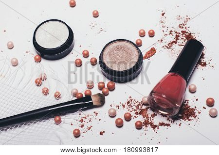 Scattered shadows applicator rouge balls and nail polish