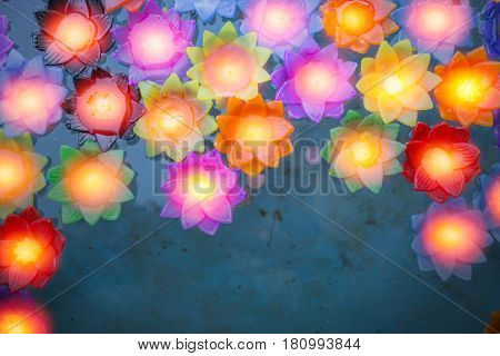 Colorful Flower Light Candle Float In The Water Pond.