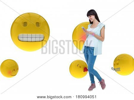 Digital composite of Happy girl sending messages with the phone on emoji background
