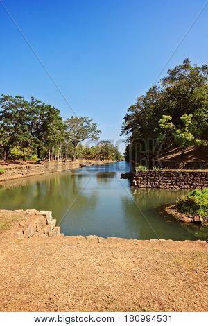 Pool around sigiriya rock in Sri Lanka vertical view