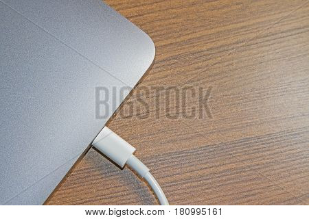 USB type-C port on laptop and Cable's White of laptop