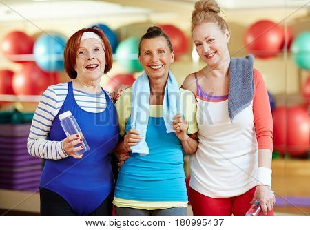 Pretty mature women in activewear looking at camera in gym