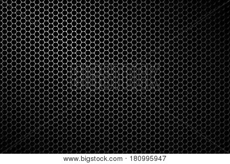 Black metal speaker mesh background. Metallic texture or pattern with hexagonal holes.