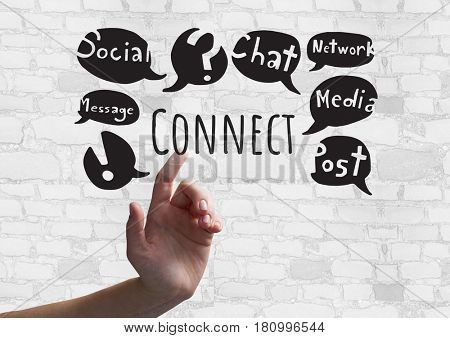 Digital composite of Hand touching Connect text with social media drawings graphics