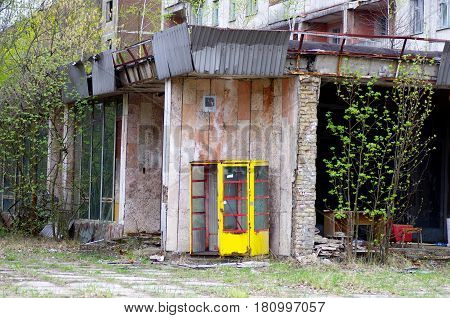 Old rusted phonebooth in a city, Ukraine
