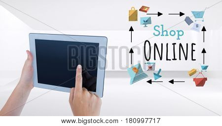 Digital composite of Touching tablet with Shop Online text with drawings graphics