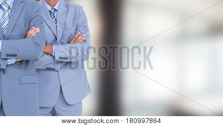 Digital composite of Two business men with blurred background