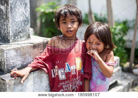 Cebu, Philippines - October 01, 2014. Children play in the yard. Everyday life of filipinos