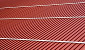 Corrugated roof metal sheets. Modern types of roofing materials. New roof of a large barn building poster