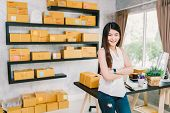 Young Asian small business owner at home office online marketing packaging and delivery scene startup SME entrepreneur or freelance woman working at home concept poster