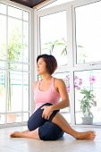 Young and healthy Asian female stretching the back of thigh muscle as part of health and fitness lif