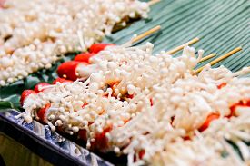 Grilled Enoki Mushroom Wrapped with Slice of Crab Sticks