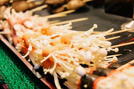 Grilled Enoki Mushroom Wrapped with Slice of Carrots