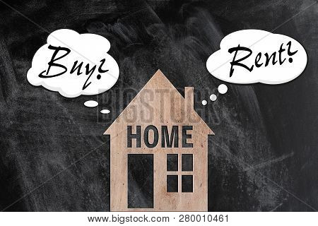 Buying Or Renting A Home Decision Making Concept With Wooden House And Thought Balloons