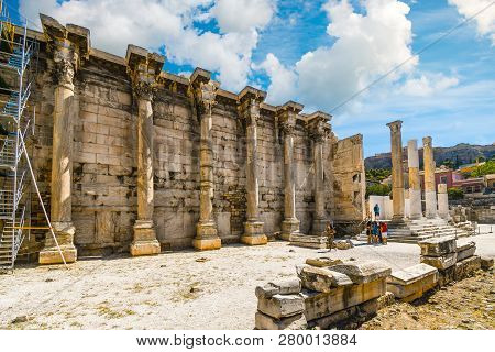 Athens, Greece - September 14 2018: Tourists Sightsee At The Ancient West Wall Of The Library Of Had