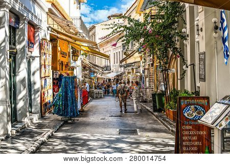 Athens, Greece - September 22 2018: Tourists Walk The Streets Lined With Souvenir  And Gift Shops An