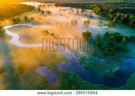 Spring Nature. Spring Landscape. Spring Scenic Background. Meadow With Blue River In Mist. Morning F