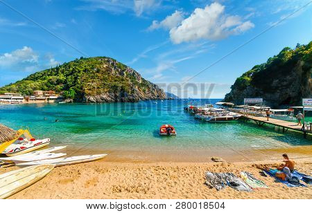 Corfu, Greece - September 16 2018: Tourists Relax In The Clear Waters And On The Sandy Palaiokastrit