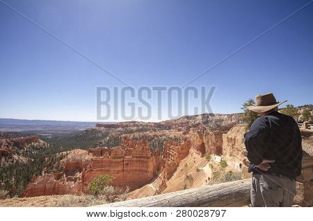 Old Man Standing Contemplating Into Bryce Canyon