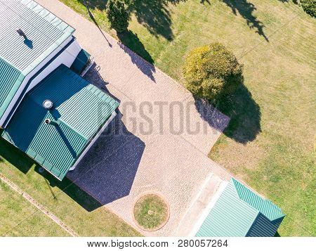 New Or Renovated Corrugated Metal Roof Of Residential House. Aerial View