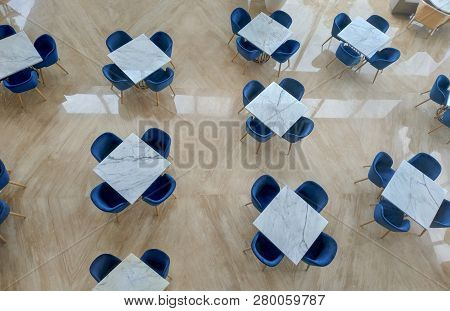 Empty Table And Chair On Restaurant Or Open Office, Top View. Concept Of Unoccupied And Abandoned Sp