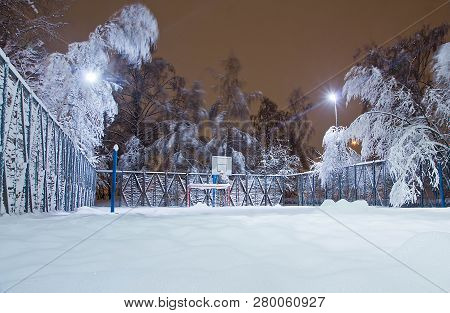 Playground And Trees In Evening Winter Park