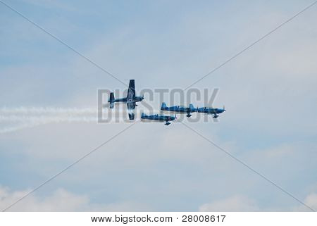 EASTBOURNE, ENGLAND - AUGUST 14: The Blades aerobatic display team perform at the Airbourne airshow on August 14, 2010. The annual event attracts thousands of visitors.