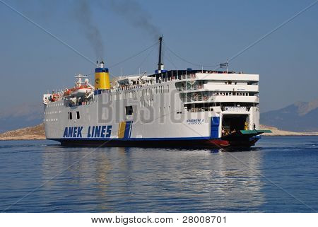 HALKI, GREECE - JUNE 14: ANEK lines ship Ierapetra L. arrives at Emborio harbour on June 14, 2010 on Halki island, Greece. Founded in 1967 in Crete, the line now operates a fleet of eleven ships.