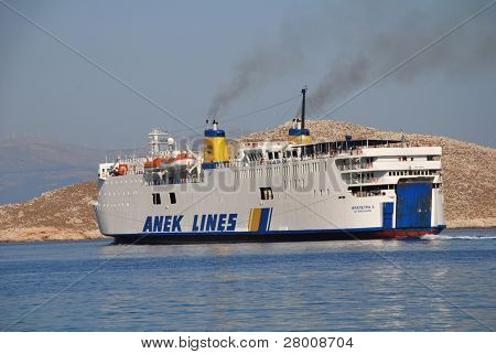 HALKI, GREECE - JUNE 14: ANEK lines ship Ierapetra L. departs from Emborio harbour on June 14, 2010 on Halki island, Greece. Founded in 1967 in Crete, the line now operates a fleet of eleven ships.
