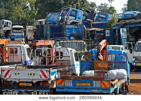 An African Truck Yard With Trucks For Sale Stacked Up Wherever There Was Room.