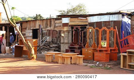 A Road Side Shop Selling Different Kinds Of Wooden Furniture In Kampala, Uganda.